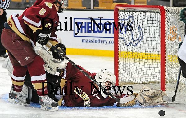 Boston: Newburyport goalie Anthony Federico (1) makes a heroic save on Canton's Mike Denehy (2) during the third period of Sunday's state championship game at the TD Garden. Photo by Ben Laing/Staff Photo