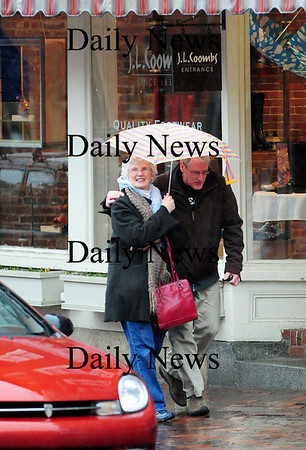 Newburyport: Tom Kiely of Gloucester shares an umbrella with his mother, Jane, who was visiting from New York. The pair were exploring downtown Newburyport on State Street, despite the rain. Photo by Ben Laing/Staff Photo