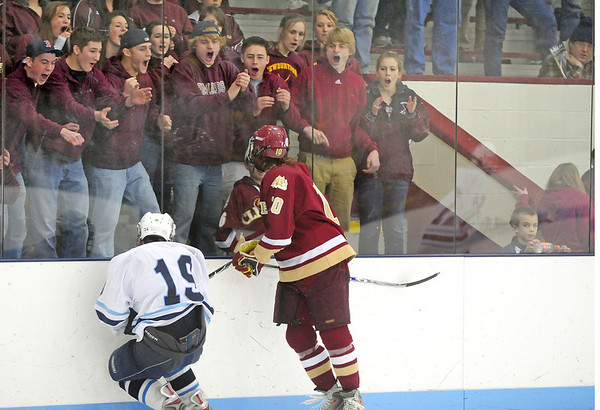 Chelmsford: Newburyport's fans cheer as Sean Hickman (10) lays a huge hit on Wilmington's Liam Gately (19) during Monday night's game in Chelmsford. Photo by Ben Laing/Staff Photo
