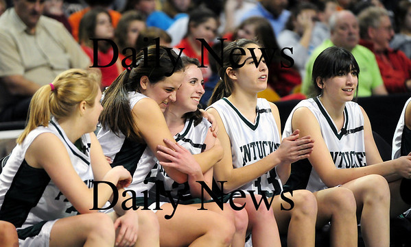 Boston: Ashley Viselli and Erin McNamara share a hug on the bench as the Sachems defeated Archbishop Williams 62-37 Tuesday at the TD Garden in Boston. Photo by Ben Laing/Staff Photo