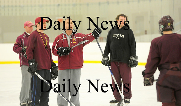 Byfield: The Newburyport High hockey team's coaching stafff, from left, Jeff Gudaitis, Jed Beauparlant, head coach Paul Yameen and Jeff Stone. Photo by Ben Laing/Staff Photo