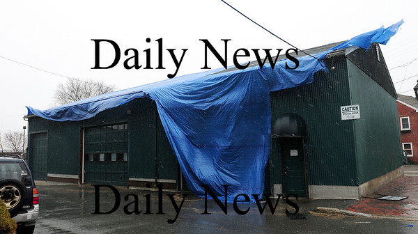 Newburyport: A warehouse belonging to The Bennett Company on Water Street in Newburyport is covered with a tarp to help protect it from the high winds and heavy rains of our latest storm. Photo by Ben Laing/Staff Photo