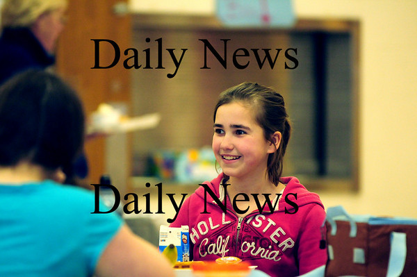 Newbury: Newbury Elementary School sixth grader Cassidy Brown enjoys lunch with her friends Monday afternoon. Cassidy has a rare heart condition know as Kawasaki disease. Photo by Ben Laing/Staff Photo
