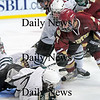 Boston: Newburyport's Gaven LaValley (7) battles with a Canton players during a scrum in front of the Bulldogs' goal at Sunday's state championship game. Photo by Ben Laing/Staff Photo