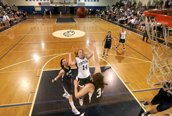 Danvers: Pentucket's Nicole Viselli (14) lays the ball in from the paint as two St. Mary's defenders attempt to stop her during Wednesday night's game. Photo by Ben Laing/Staff Photo