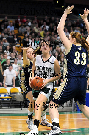 Boston: Pentucket's Ashley Viselli (24) splits the Archbishop Williams defenders on her way to the basket during Tuesday's 62-37 win at the TD Garden. Photo by Ben Laing/Staff Photo