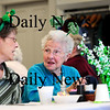 "Merrimac: Kathy Sciacca, left, sings along to ""Danny Boy"" with her mother, Jean Adams, during Wednesday's St. Patrick's Day lunch at the Merrimac senior center. Photo by Ben Laing/Staff Photo"