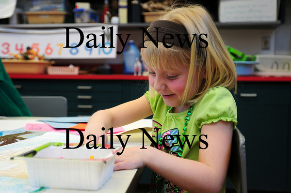 Amesbury: Amesbury kindergartener Nixie Raymond sorts through different color crayons while working on a picture of her home in art class at the Cashman School on Wednesday. Photo by Ben Laing/Staff Photo