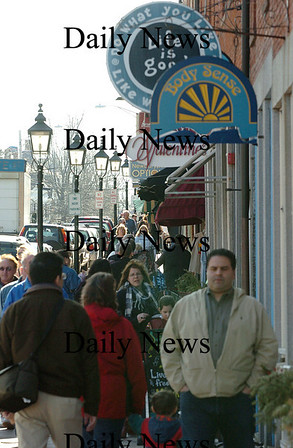 Newburyport: Newburyport's sidewalks were busy with people eager to enjoy the spring like temperatures Sunday afternoon. People walking dogs, babies in strollers and ice cream cones were the norm for downtown Newburyport this weekend. Photo by Ben Laing/Staff Photo