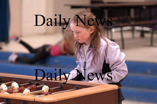 Salisbury: Olivia Doane, 9, of Salisbury, concentrates on her fooseball game Tuesday afternoon at the Salisbury Boys and Girls Club. Photo by Ben Laing/Staff Photo