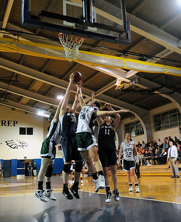 Danvers: Pentucket temmates Ashley Viselli (24) and Tess Nogueira (32) battle with St. Mary's Tori Faiera (32) and Kirsten Ferrari (11) for a rebound during Wednesday night's game in Danvers. Photo by Ben Laing/Staff Photo