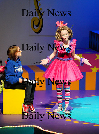 """Newbury: Ania Burgess, 11, right, and Sarah Collins, 12, left, rehearse a scene from Newbury Elementary's upcoming play """"Circus-O-Scenario"""". Photo by Ben Laing/Staff Photo"""