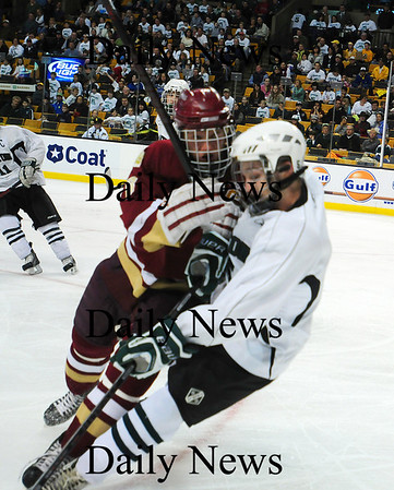 Boston: Newburyport's Derek Freeman lays out a Canton player during Sunday's state championship game at the TD Garden. The Clippers would fall to the Bulldogs 4-2 in a rematch of last year's game. Photo by Ben Laing/Staff Photo