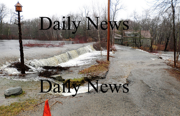 Byfield: River Road in Byfield succumbed to the rising Parker River Monday afternoon as the area was soaked in heavy rain all weekend. Photo by Ben Laing/Staff Photo