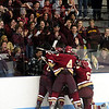 Chelmsford: The Newburyport hockey team mobs senior Derek Freeman after the captain scored the opening goal of Monday night's game against undefeated Wilmington. Photo by Ben Laing/Staff Photo
