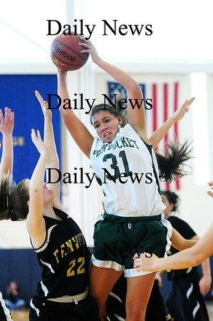 Boston: Pentucket's Sarah Higgins (31) pulls down a rebound during Saturday's win over Bishop Fenwick at Emmanuel College in Boston. Photo by Ben Laing/Staff Photo