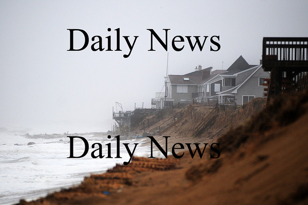 Newbury: The homes along Plum Island brace for yet another nor'easter Tuesday, complete with high tides, strong winds and heavy rain. Photo by Ben Laing/Staff Photo