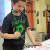 Newbury: Newbury Elementary third grader, Josh Lind, 8, experiments with color during art class Wednesday. He and most of his classmates were decked out in green for St. Patrick's Day. Photo by Ben Laing/Staff Photo