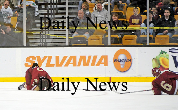 Boston: Newburyport's Billy Boudreau (2) and Connor Wile (6) are slow to pick themselves off the ice as the Clippers gave up an empty net goal with less than a minute left to Canton, falling to the Bulldogs 4-2. Photo by Ben Laing/Staff Photo