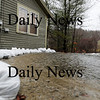Byfield: This home on River Road in Byfield has set up sand bags to help protect it from the rising Parker River, which has washed out a strech of road nearby. Photo by Ben Laing/Staff Photo