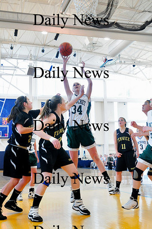 Boston: Pentucket's Vanessa Cahill (34) puts back a rebound during Saturday's game against Bishop Fenwick at Emmanuel College. Photo by Ben Laing/Staff Photo