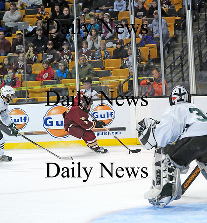 Boston: Newburyport's Billy Boudreau (2) skates past a Canton defender on his way to the net during Sunday's state championship game at the TD Garden. Photo by Ben Laing/Staff Photo