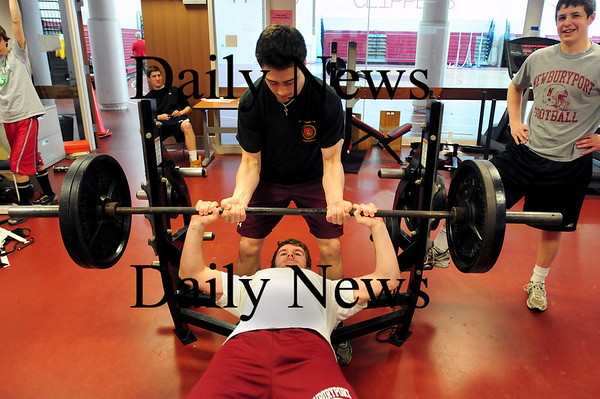 Boston: Billy Boudreau of the Newburyport hockey team works out at in the school's weight room with the help of classmate Dean Cataldo. The Clippers hockey team has made a commitment to improving their conditioning and strength, which had paid off with back to back state championship appearances. Photo by Ben Laing/Staff Photo