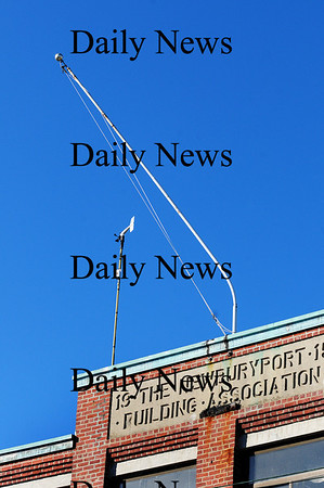 Newburyport: The flagpole atop the Merrimac Mill building on Merrimac Street in Newburyport was bent at an odd angle after the recent storms and their high winds. Photo by Ben Laing/Staff Photo