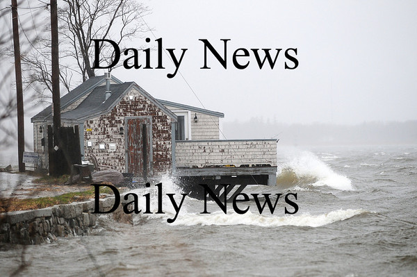 Newburyport: The clam shack along Water Street in Newburyport stares down another nor'easter Tuesday, with waves lapping at its deck during high tide. Photo by Ben Laing/Staff Photo