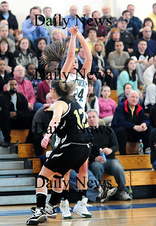 Boston: Pentucket's Ashley Viselli (24) attempts a three pointer while defended by Bishop Fenwick's Kaela Murphy (12) during Saturday's game at Emmanuel College in Boston. Photo by Ben Laing/Staff Photo