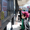 Salisbury: Dylan Copeland, 11, from Salisbury, places his first order of the season at Dairy Queen on Rt. 110. The ice cream shop officially opened on Friday, serving all kinds of treats, like Dylan's favorite, lime slush. Photo by Ben Laing/Staff Photo
