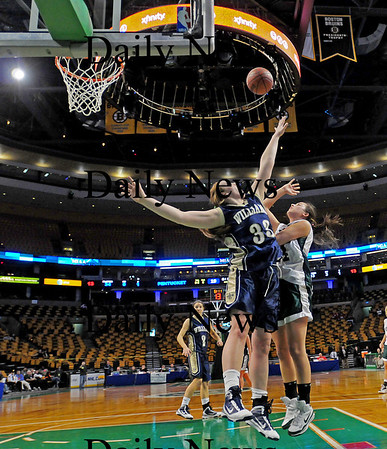 Boston: Pentucket's Ashley Viselli (24) shoots a ball over Archbishop Williams' Valerie Driscoll (33) during the Sachems 62-37 win at the TD Garden on Tuesday. Photo by Ben Laing/Staff Photo