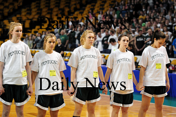 Boston: The Sachems' starting line up, from left, Vanessa Cahill, Emily Lane, Holly Jacobsons, Erin McNamara and Ashley Viselli, hold hands during the National Anthem at Tuesday's game at the TD Garden in Boston. Photo by Ben Laing/Staff Photo