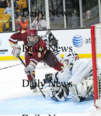 Boston: Newburyport's Derek Freeman (8) slips the puck past Canton goalie Jon Donaruma (30) for the Clippers' first goal of Sunday's state championship game at the TD Garden. Photo by Ben Laing/Staff Photo