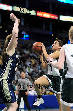 Boston: Pentucket's Sarah Higgins (31) leaps for a lay up during Tuesday's win over Archbishop Williams at the TD Garden in Boston. Photo by Ben Laing/Staff Photo