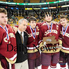 Boston: The Clipper captains, Billy Boudreau (2), Ryan Cutter (11), Derek Freeman (8) and Kyle McElroy (3), pose with Coach Paul Yameen with the runner up trophy from Sunday's state final. Newbuyport fell to Canton 4-2. Photo by Ben Laing/Staff Photo