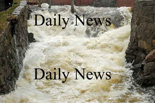 Amesbury: The Powow River along the Upper Millyard in Amesbury, roars over the waterfall Monday morning during the most recent rain storm. Photo by Ben Laing/Staff Photo