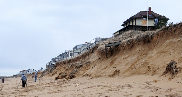 Newbury: The dunes south of the central groin on Plum Island were ravaged by the high tides and storms from the past week, with many homes suffering damage. Photo by Ben Laing/Staff Photo