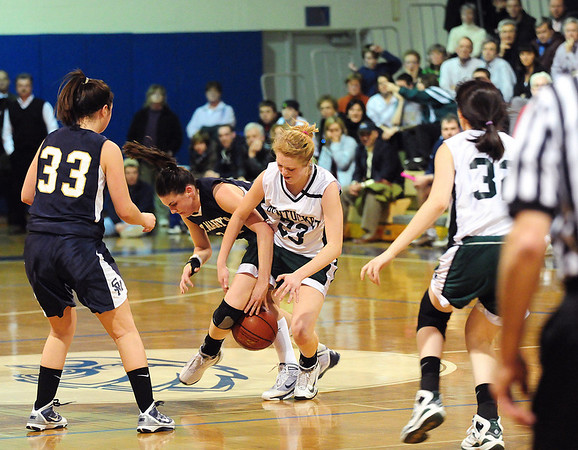 Danvers: Pentucket's Holly Jakobsons (23) collides with St. Mary's Bria Tiro (34) while both try to secure a loose ball during Wednesday night's game. Photo by Ben Laing/Staff Photo