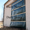 Newbury: The historic barn at the Spencer-Pierce Little farm in Newbury suffered some damage from last week's storm. One of the doors was ripped off by the high winds. Photo by Ben Laing/Staff Photo