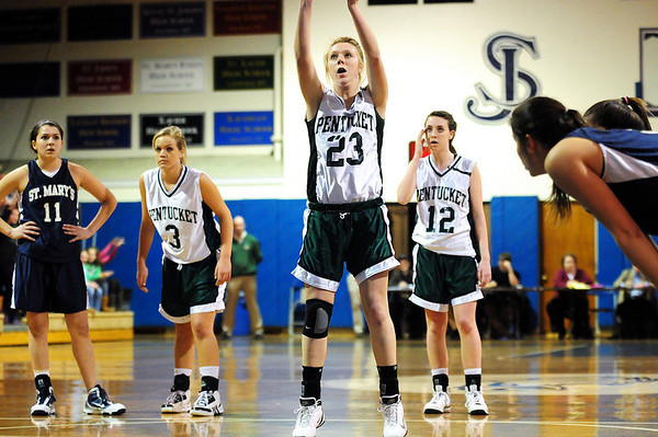 Danvers: Pentucket's Holly Jakobsons (23), flanked by teammates Emily Lane (3) and Erin McNamara (12), shoots a pair of free throws during Wednesday night's game against St. Mary's. Photo by Ben Laing/Staff Photo