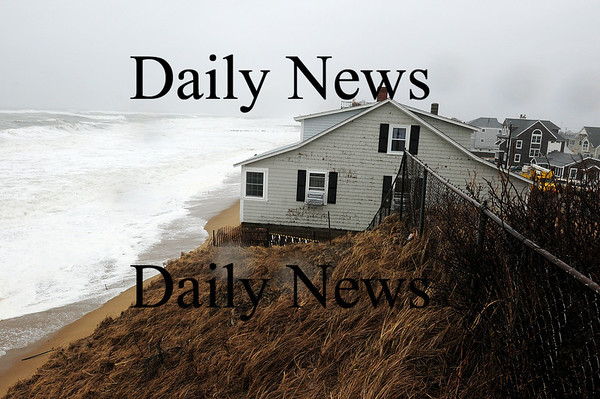 Newbury: This home at 27 Annapolis Way on Plum Island was evacuated Monday morning as it was in danger of being damaged by the high tide, which washed away virtually all the dune that was protecting the property. Photo by Ben Laing/Staff Photo