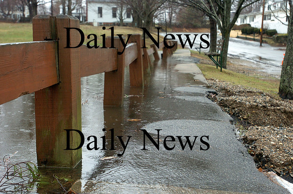 Amesbury: The waters from the pond at Amesbury Town Park rose to the very edge of the sidewalk along Greanleaf Street Tuesday morning, as the area sees more rain this week. Photo by Ben Laing/Staff Photo