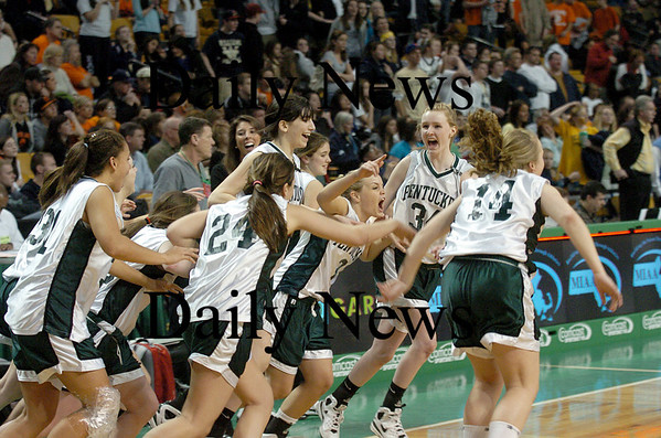 Boston: The Pentucket Sachems storm the court after defeating Archbishop Williams 62-37 Tuesday at the TD Garden in Boston. Photo by Ben Laing/Staff Photo