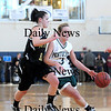 Boston: Pentucket's Emily Lane (3) cuts through the lane while Bishop Fenwick's Amy Pelletier (11) tries to keep up during Saturday's game at Emmanuel College in Boston. Photo by Ben Laing/Staff Photo