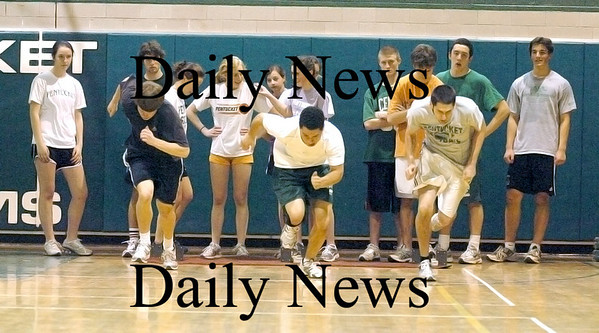 West Newbury: Dan Greene, left, Devrick Felder, and CJ Lataille, right, work out in the Pentucket gym Tuesday afternoon. The trio are members of the Pentucket boys track team. Photo by Ben Laing/Staff Photo