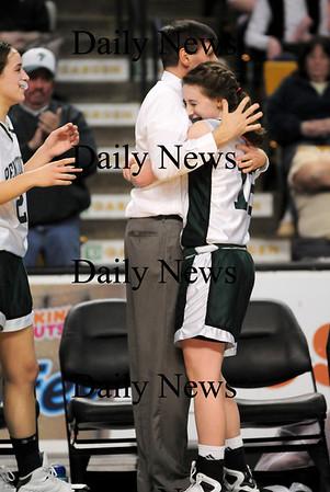 Boston: Coach John McNamara and his daughter, senior Erin McNamara share a hug as the Pentucket Sachems defeated Archbishop Williams 62-37 Tuesday at the TD Garden in Boston. Photo by Ben Laing/Staff Photo