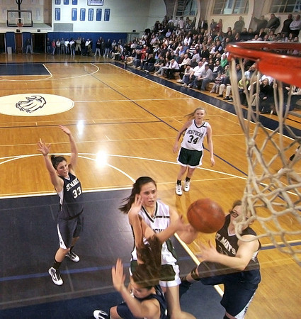 Danvers: Pentucket's Ashley Viselli (24) fights off two St. Mary's defenders on her way to the hoop during Wednesday night's game in Danvers. Photo by Ben Laing/Staff Photo