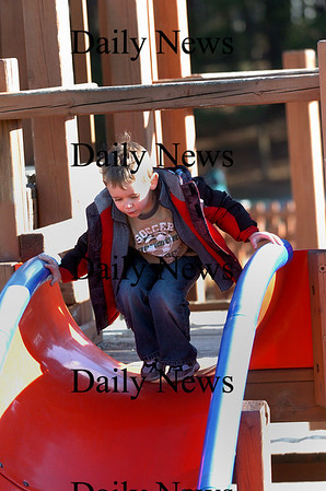 Amesbury: Sam Guimaraes, 4, of Amesbury, prepares to take a trip down the slide at the Amesbury town park Monday afternoon. Photo by Ben Laing/Staff Photo