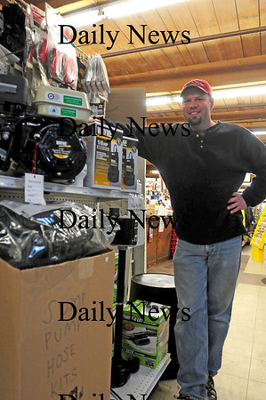Amesbury: Craig Eaton of Amesbury Industrial Supply stands with their selection of sump pumps, which have been a hot commodity over the past few weeks. They are expecting a shipment of 150 more pumps to arrive for the start of business on Tuesday. Photo by Ben Laing/Staff Photo
